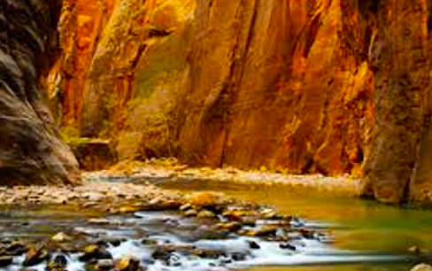 river surrounded by red rock