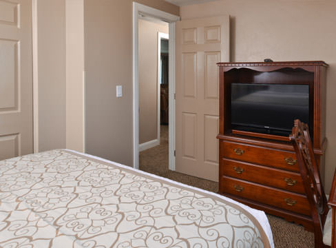 room with TV and bed